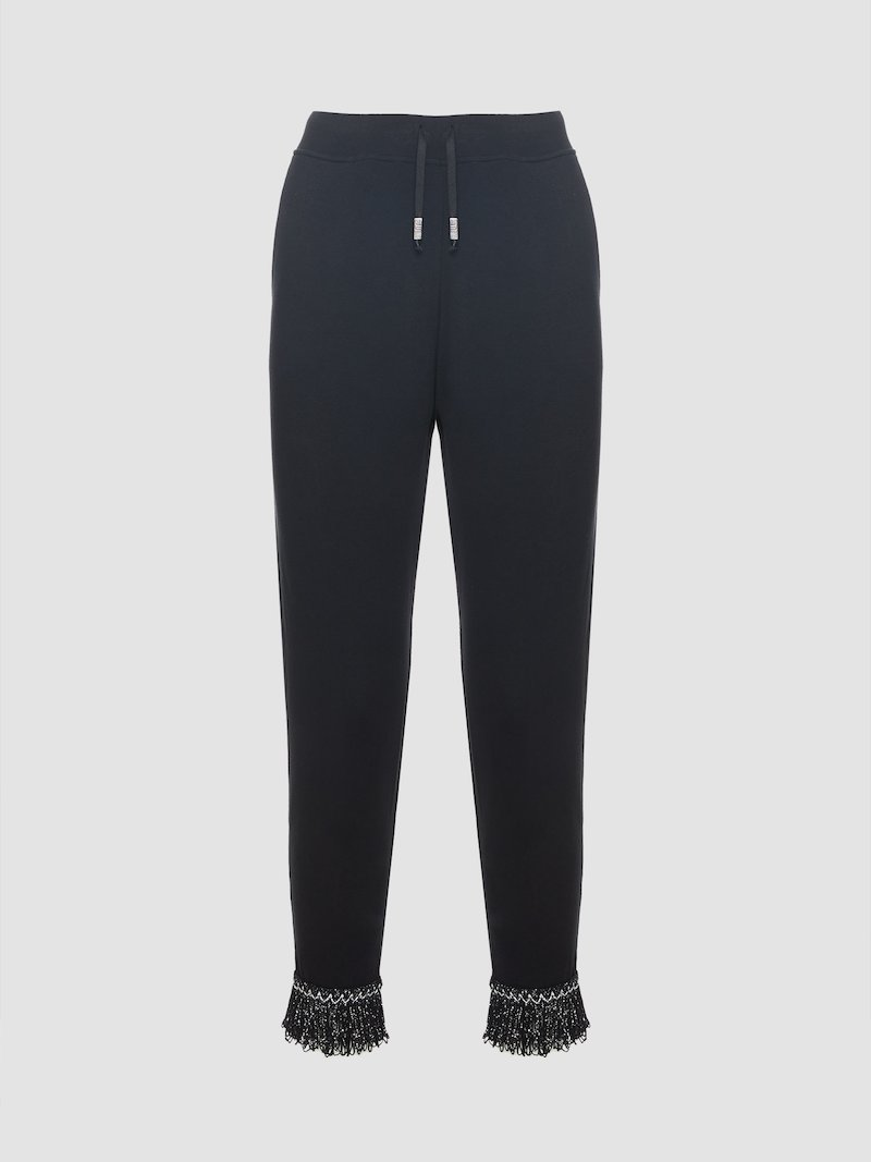 Black trousers with applications
