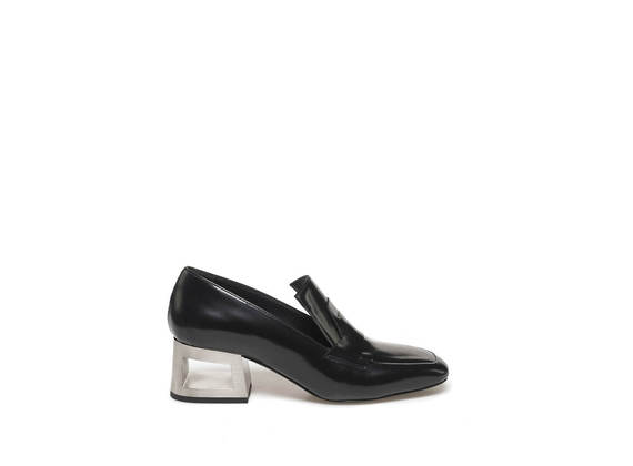 Black loafer with steel-coloured perforated heel
