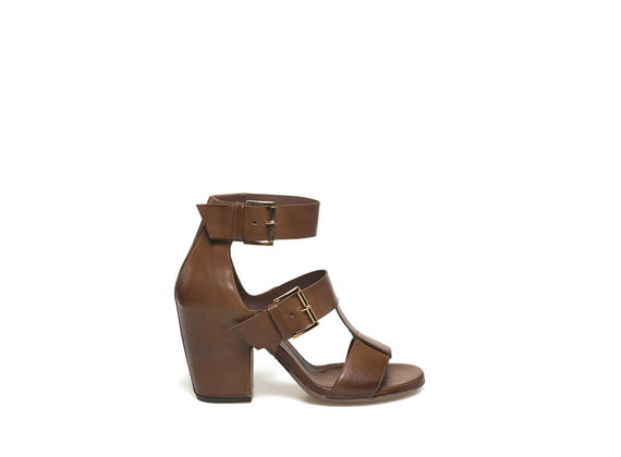 Cognac-coloured sandal with buckles and shell-shaped heel