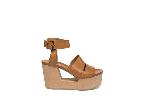 Hide-coloured sandal on perforated wooden wedge