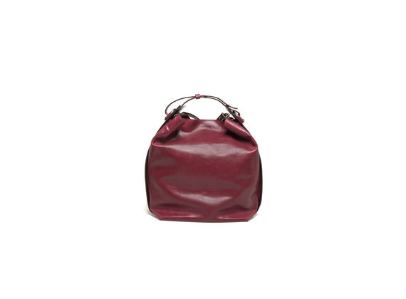 Red bucket bag with piercing