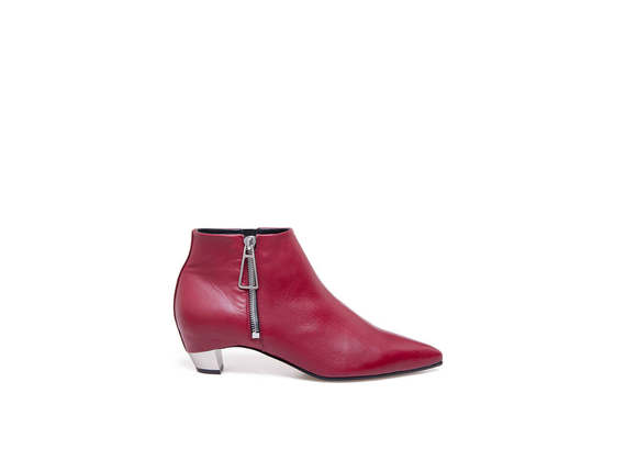 Red pointed toe ankle boots with side zip and metal heel