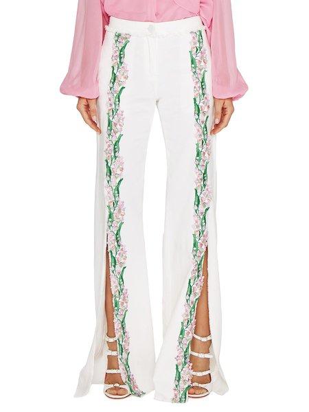 Pantalones con aberturas y bordado