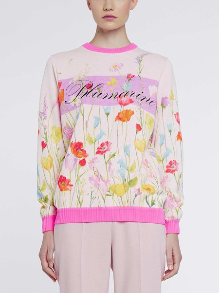 Sweater featuring floral print with logo