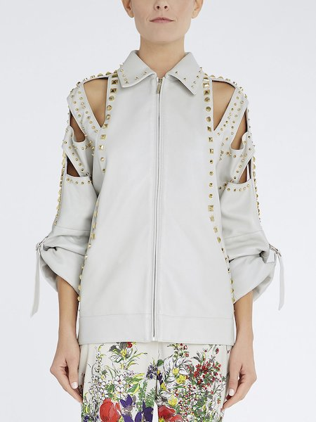 Leather jacket with cut-outs and studs - white