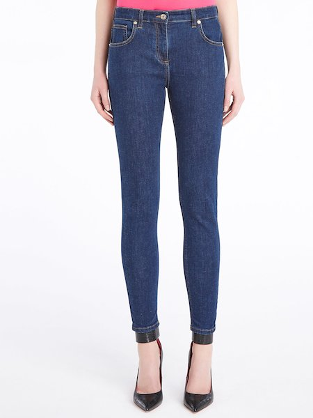 Skinny jeans with rhinestone logo