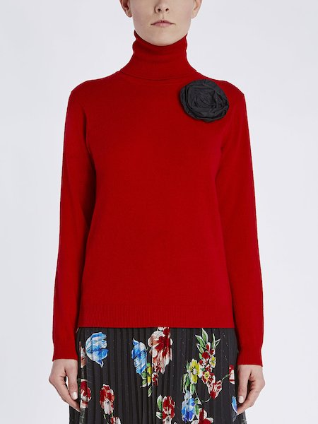Jersey de cuello alto con flor aplicada