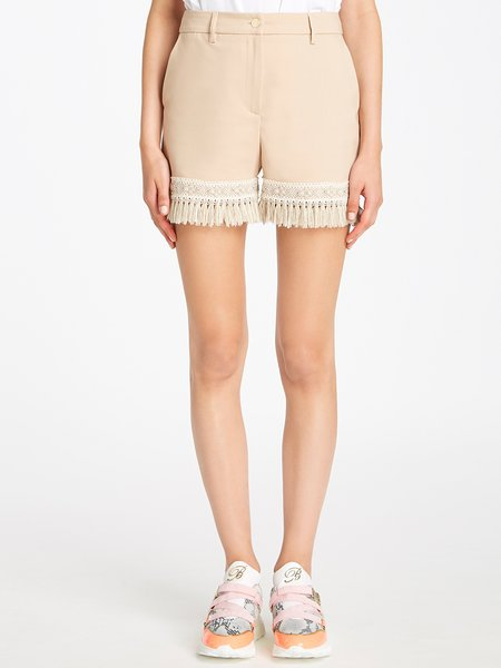 Shorts with fancy trim and fringe