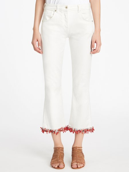 Jeans embroidered with beads, sequins and coral