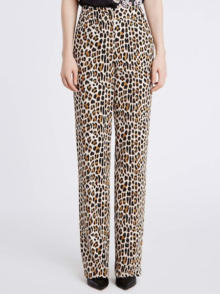 Trousers in cotton featuring animalier print