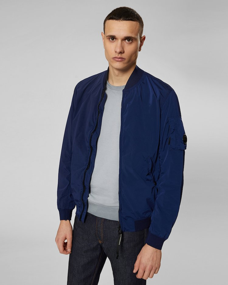 Nycra Lens Bomber Jacket in Estate Blue