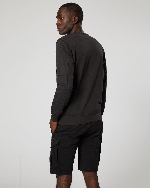 c3e53ebc2e9f6e Garment Dyed Light Fleece Lens Crew Sweatshirt In Black | C.P. ...