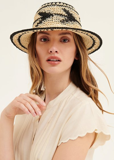 Cael beige and black hat