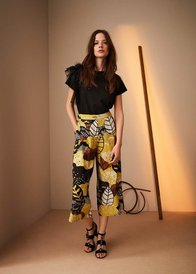 Megan Naive print trousers