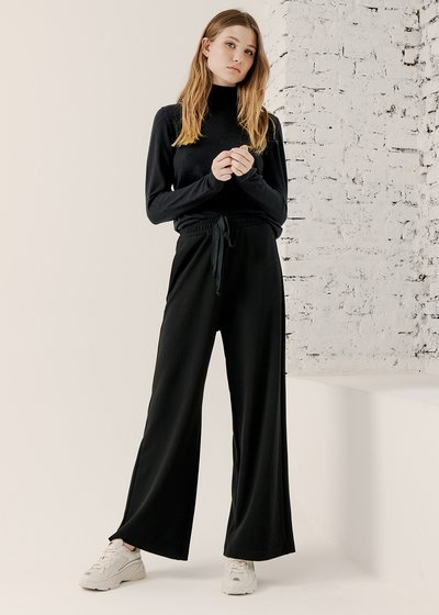 Padel Flared Trousers in Black