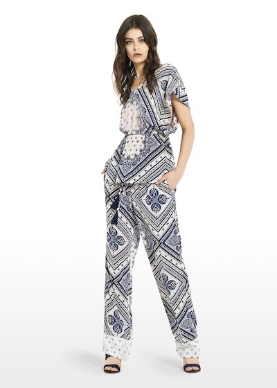 Pantaloni Parker all over printed con ricamo