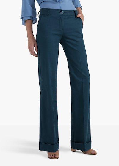 Pantaloni Pilad modello a zampa con risvolto al fondo