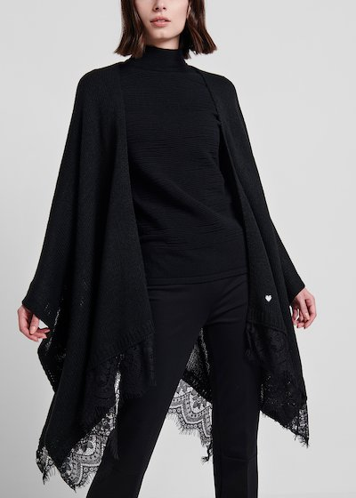 Black knit cape with lace at the bottom