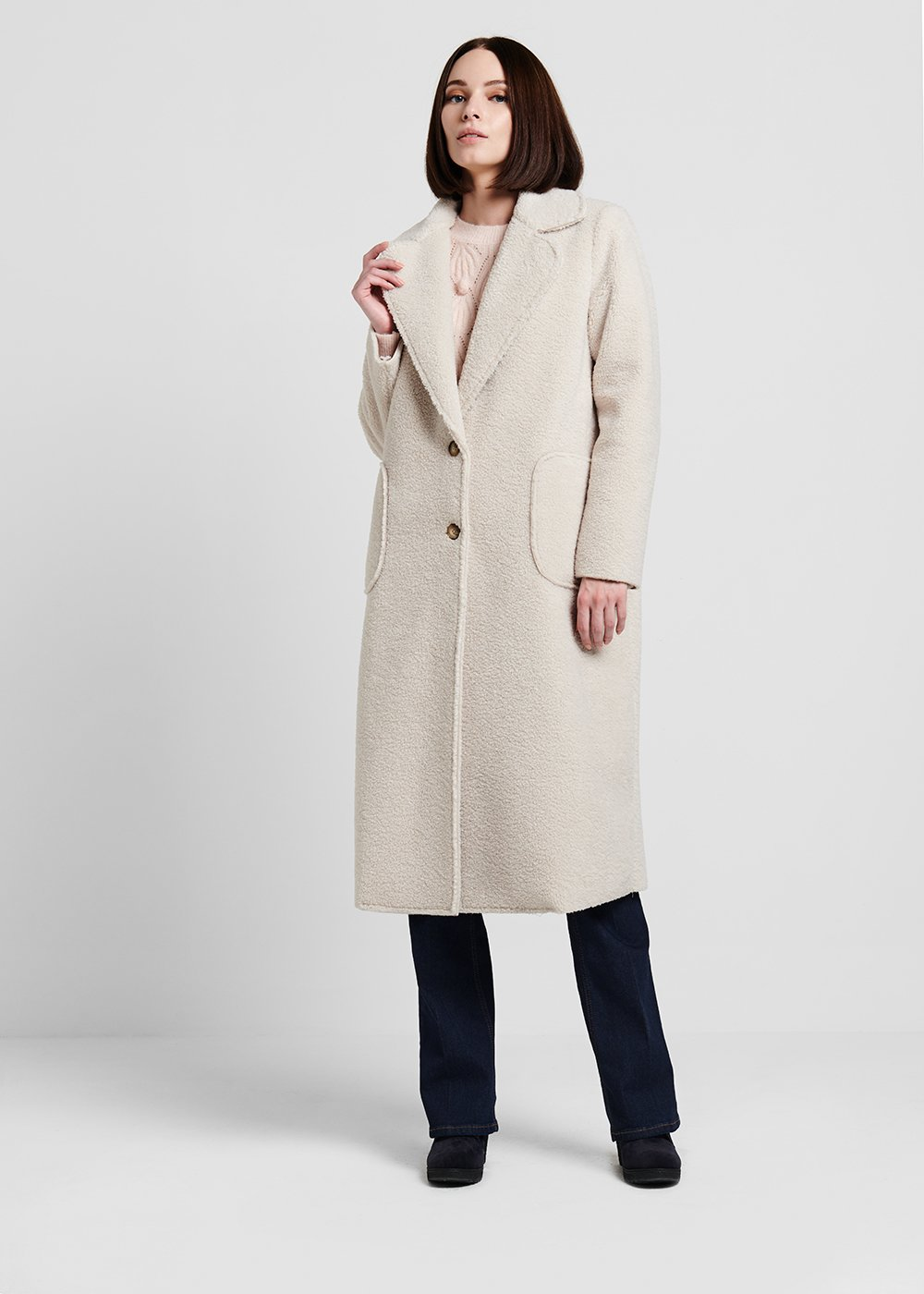 Coat in raw faux sheepskin fabric