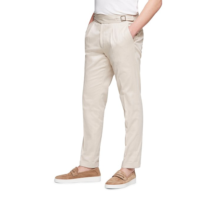 Trousers with side buckles