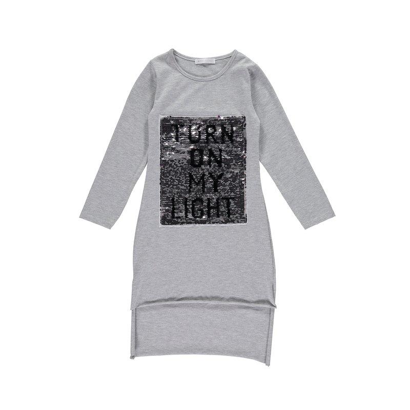 Camiseta asimétrica manga larga niña con lentejuelas