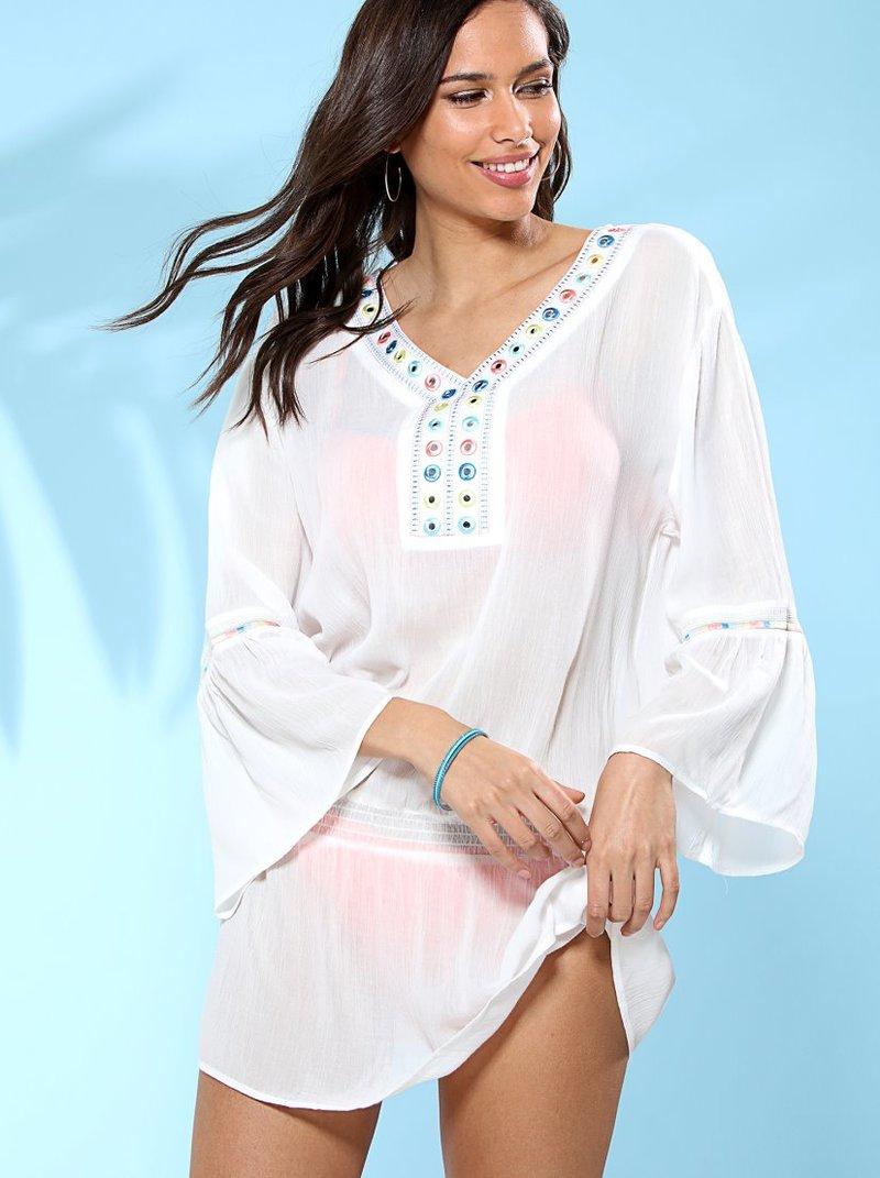 Blusa túnica larga con aplicaciones y bordados