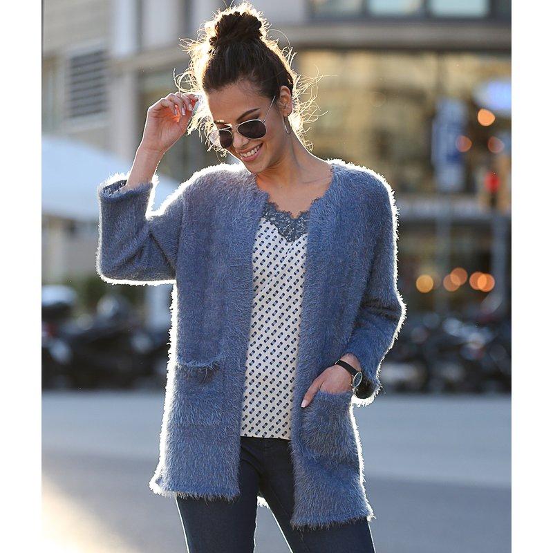 Chaqueta tricot de suave pelo peluche con bolsillos