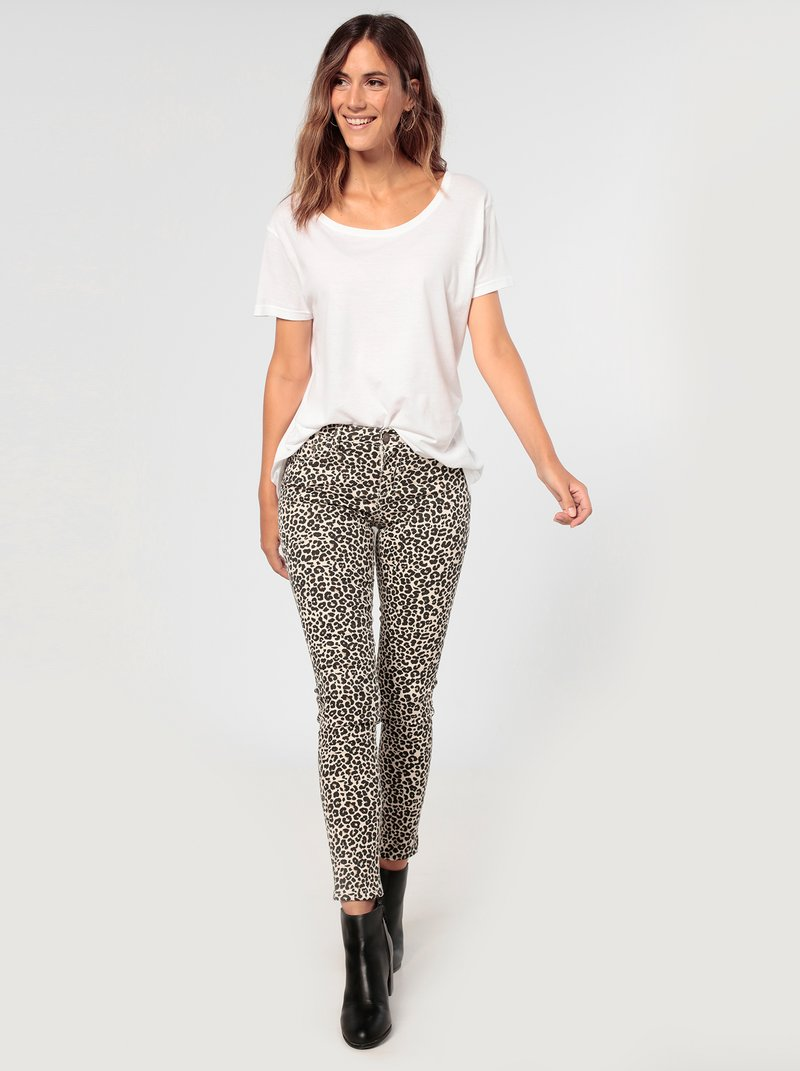 Pantalón tiro medio skinny fit animal print