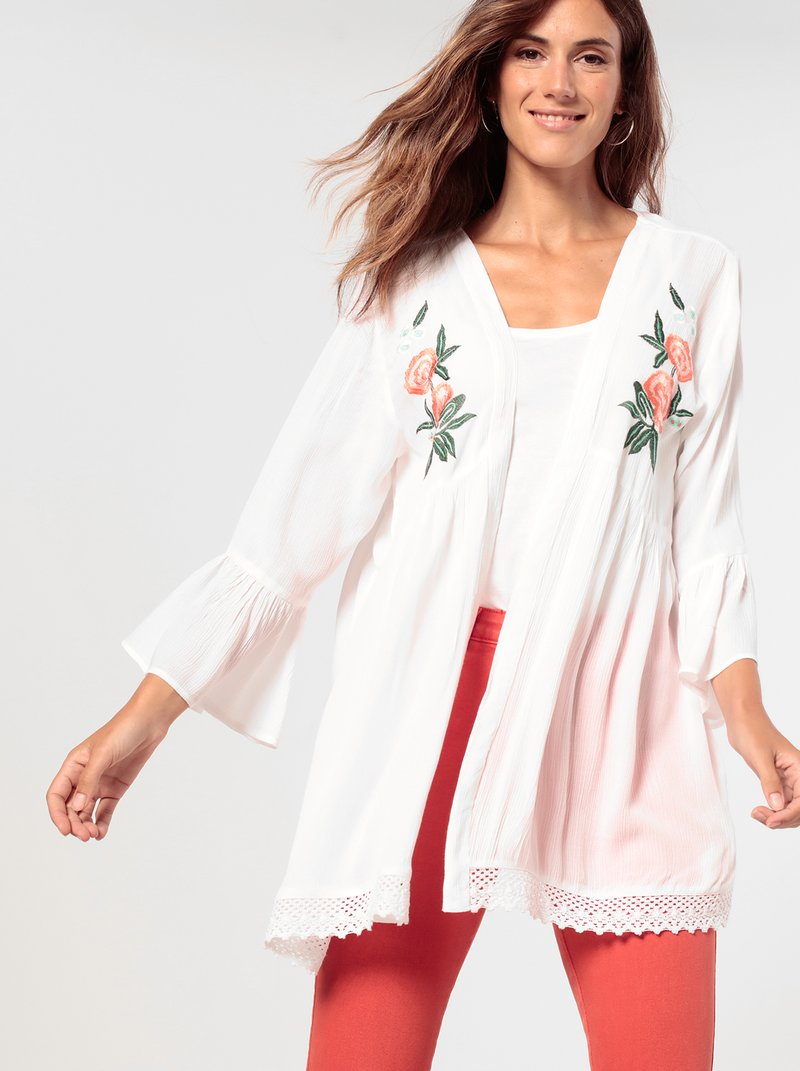Blusa kimono bordada bajo asimétrico