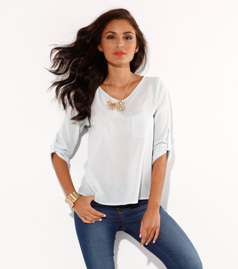 Blusa mujer manga larga regulable con bolsillo