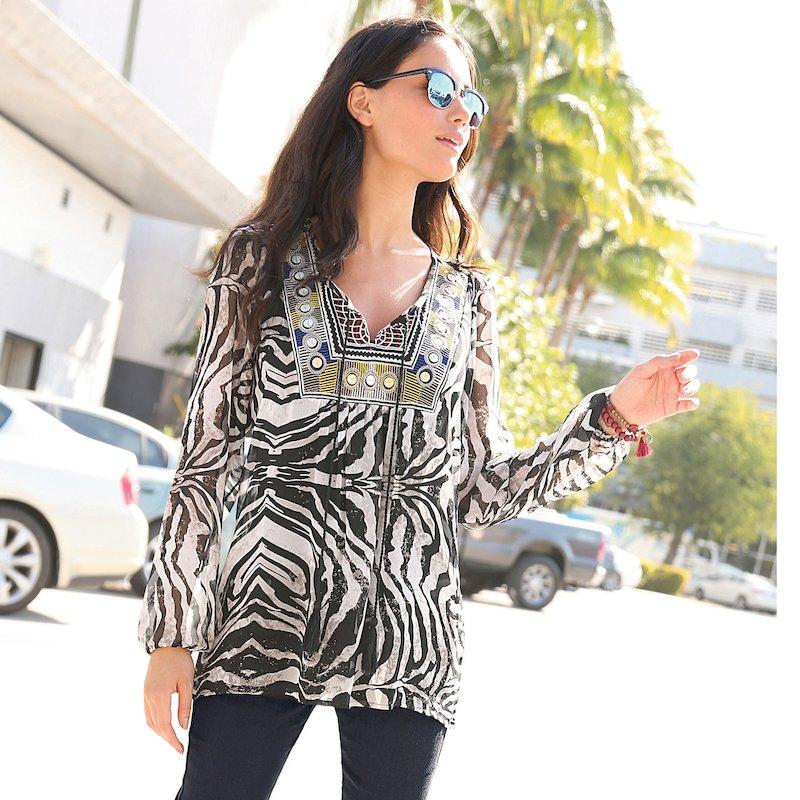 Blusa mujer de manga larga con bordado y borlas