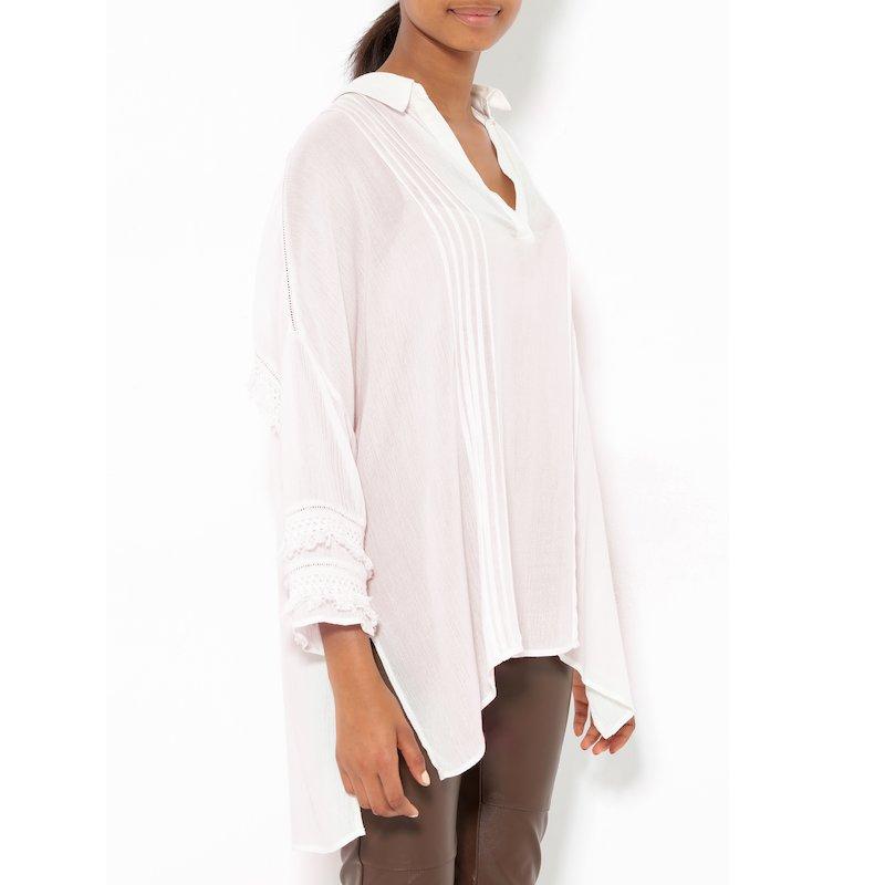 Blusa oversize mujer manga larga con jaretas flecos
