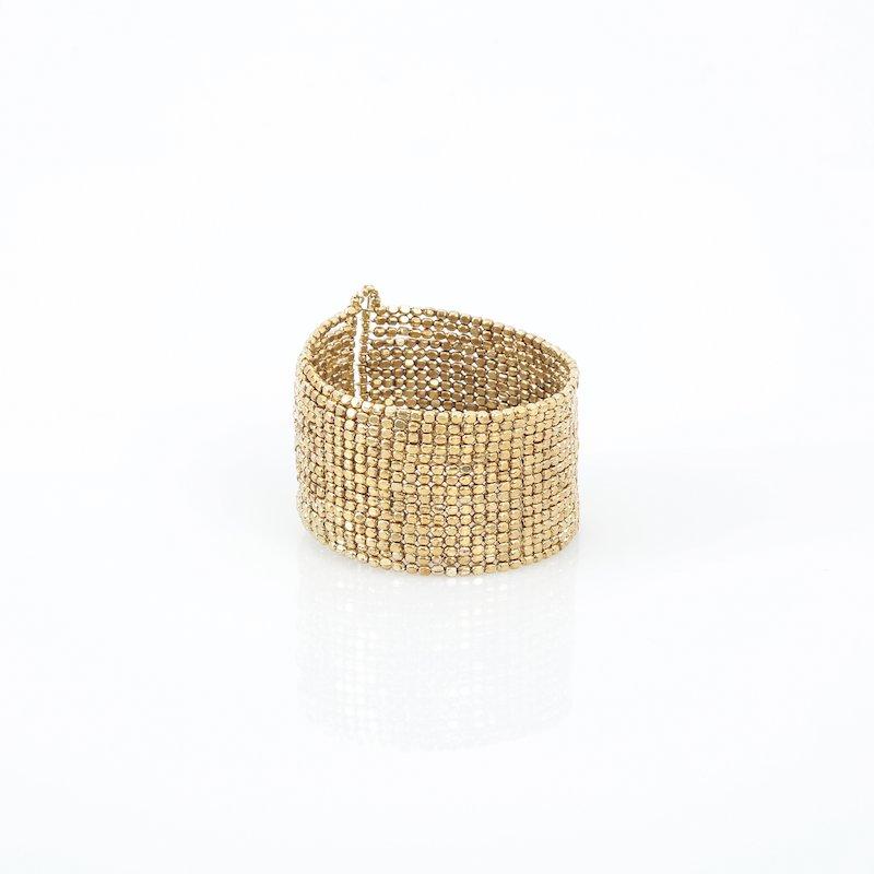 Pulsera brazalete semi rígida de metal dorado ajustable