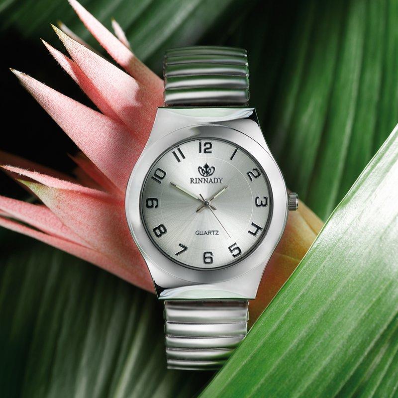 Reloj analógico de señora plateado correa elástica
