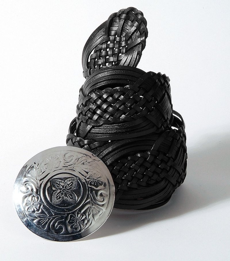 Cinturón mujer en símil piel con diseño trenzado