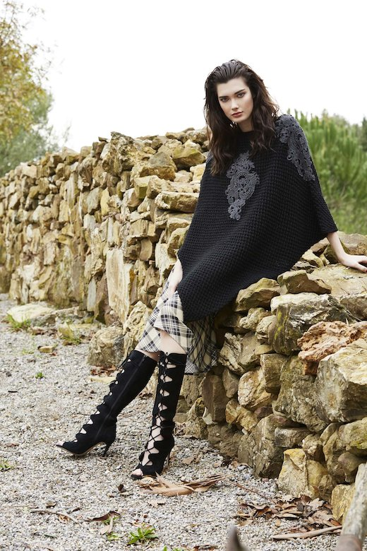 BLACK PONCHO WITH APPLICATIONS
