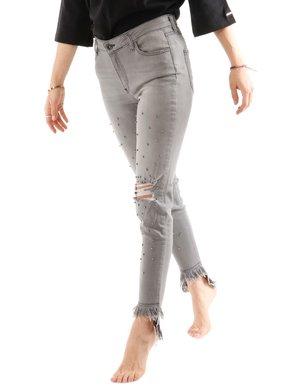 Jeans Imperfect con strappi e borchie