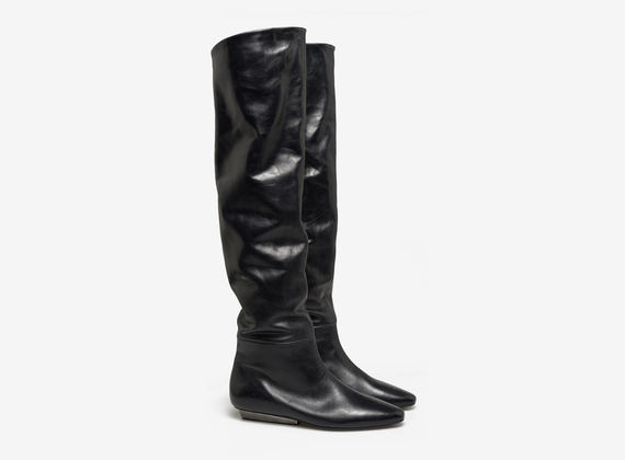 Thigh high boot with metal heel