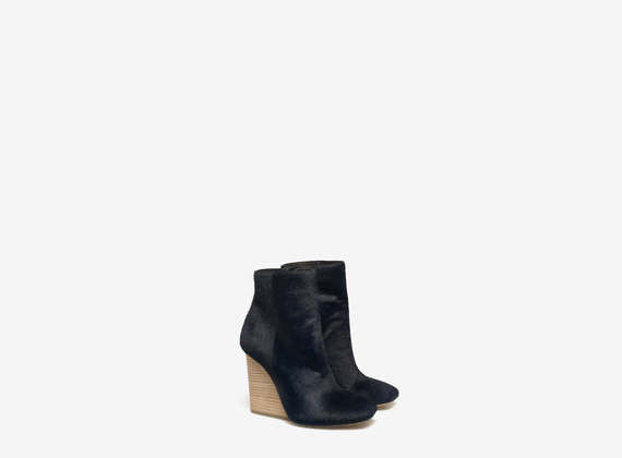 Ponyskin ankle boots with leather wedge
