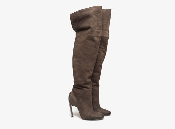 Thigh high boot with ponyskin flap