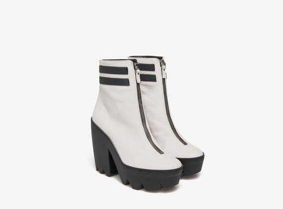 Zip ankle boots with elasticated band