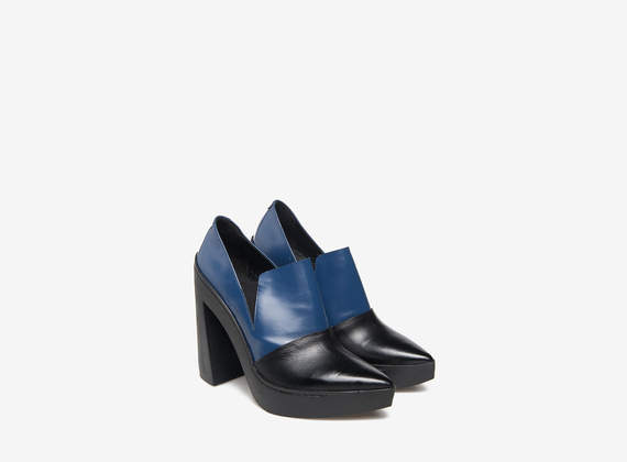 Blue moccasins on black rubber