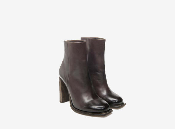 Metal toed ankle boots