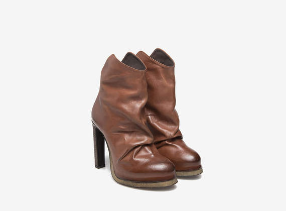 Pleated leather cowboy ankle boots