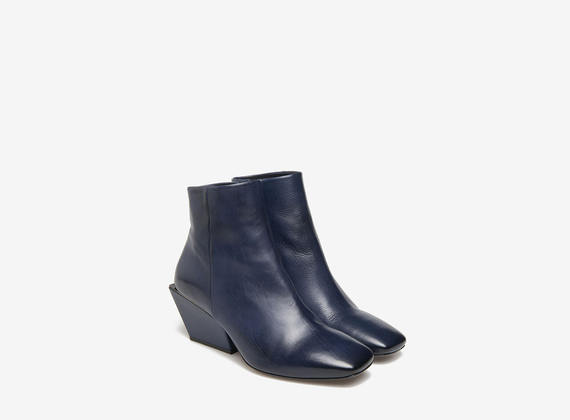 Square ankle boots on geometric heels