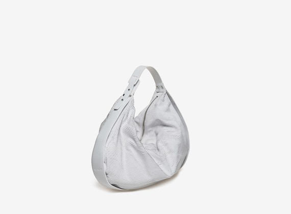 White engraved crescent shaped duffel bag