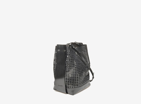 Laminated perforated leather satchel