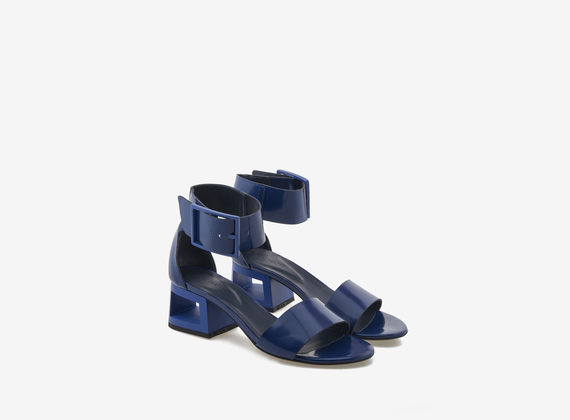 Blue brushed leather sandal with perforated heel