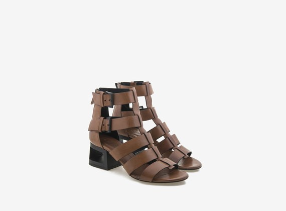 Nude-colour ankle boot with perforated contrast heel