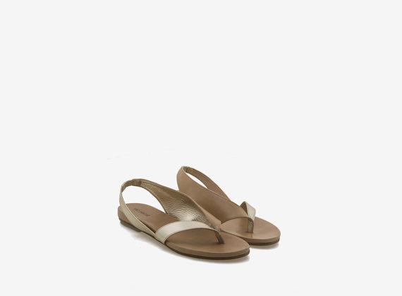 Asymmetrical flip-flop sandal in laminated leather - Laminated Platinum / Brown